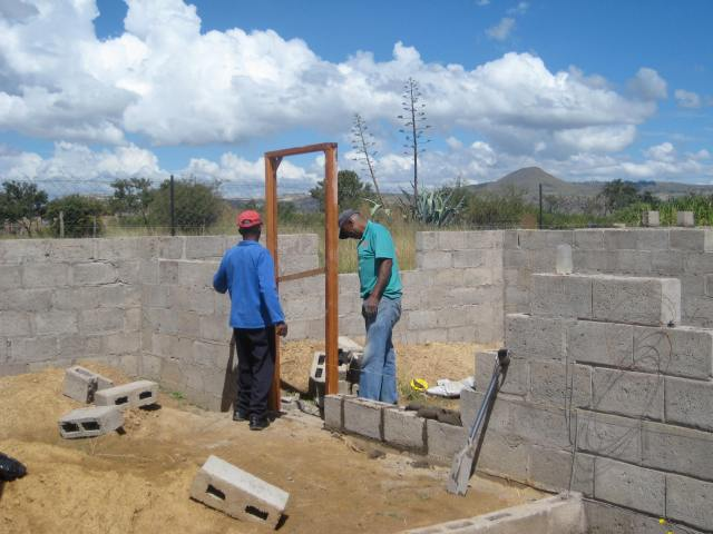 The first door frame to go in was the one between the garage and kitchen. It was a gift from our friends in Joburg!