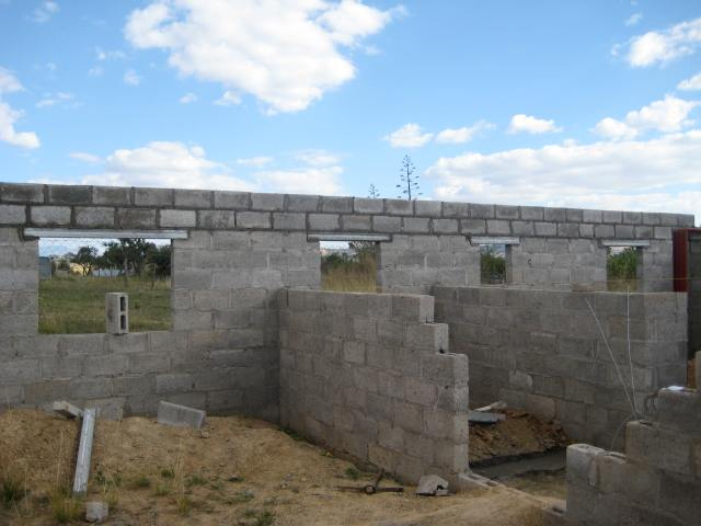 This shows the back wall at its final height! The windows (left to right) are of the kitchen, main bathroom, master bathroom, and master bedroom.