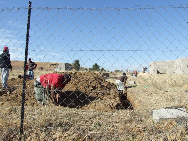 Digging the foundation for dorms at the LXP Lesotho Base.