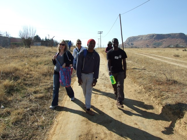 Visiting people in Nkoeng Village during community outreach.