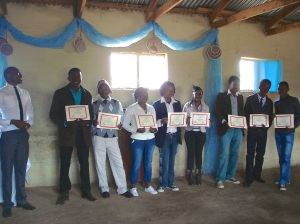 The graduates with their certificates