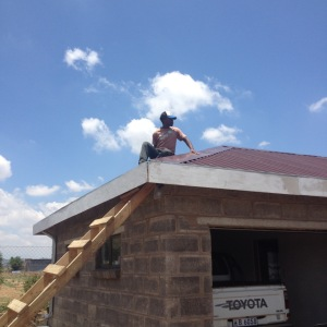 Risky business: putting sealant around the nails so the roof will not leak